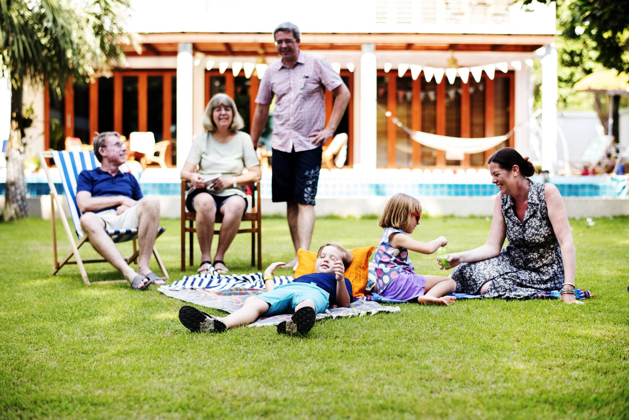 Caucasian family enjoying summer together at backyard