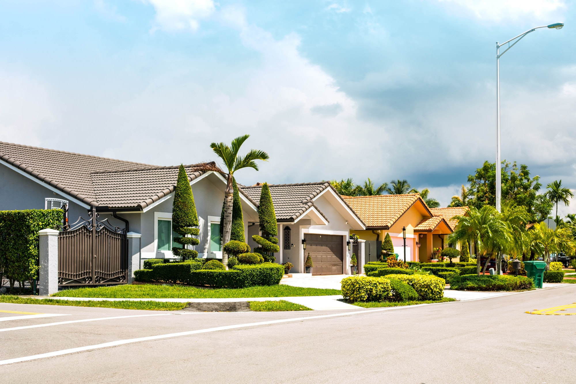 Set of Florida modern luxury houses in a residential neighborhood area.
